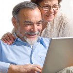 AgeNation Relationships - couple at a laptop computer