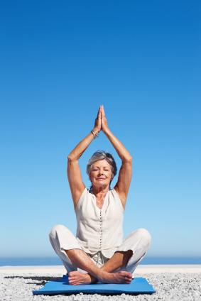 De-aging - mature woman in yoga pose