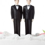 Gay marriage - two grooms on a wedding cake